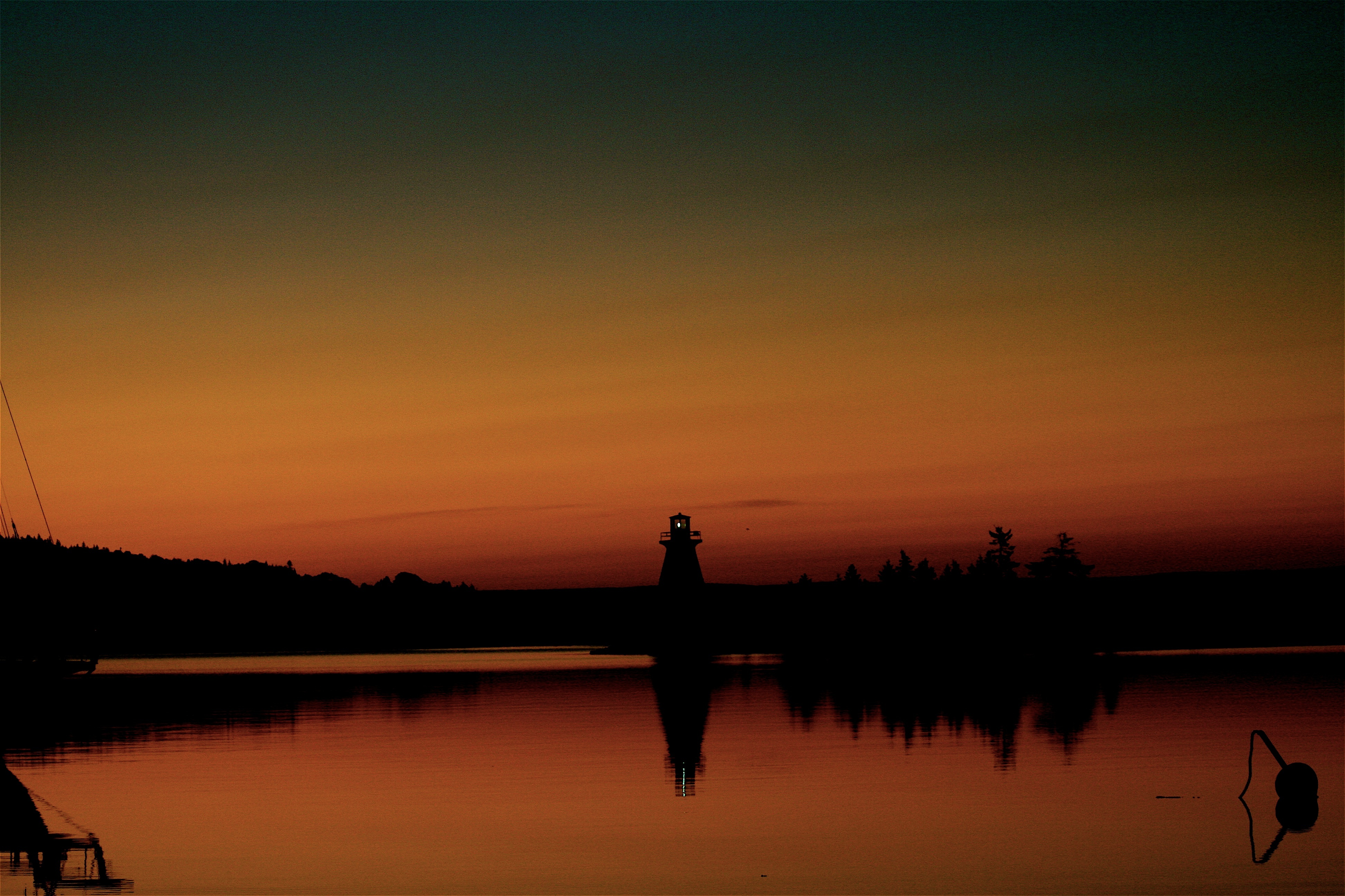 Nova Scotia coastal bike tour lighthouse sunset
