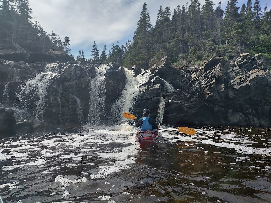 kayaking in Newfoundland by waterfall