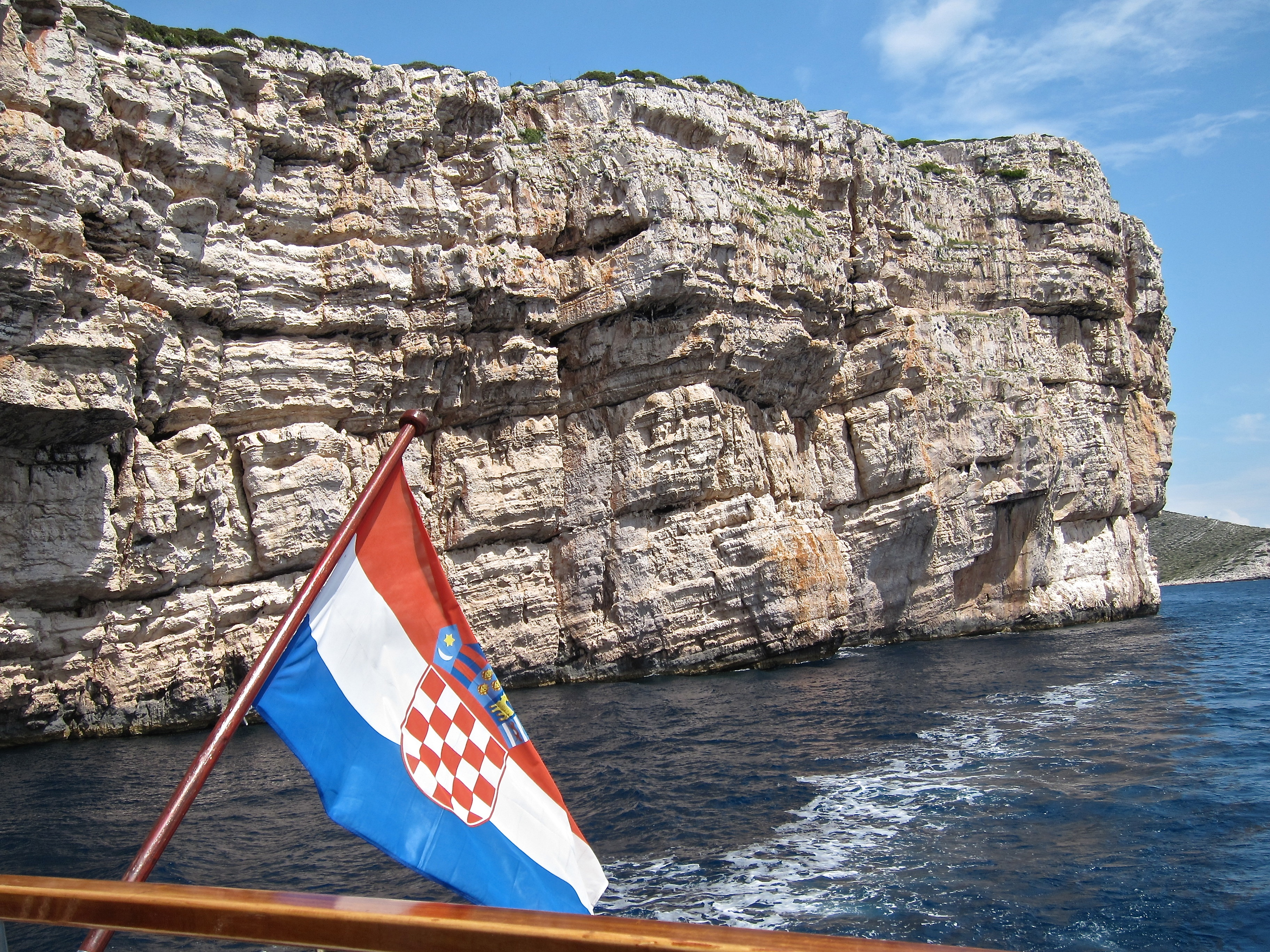 Croatia National Parks bike tour boat and flag