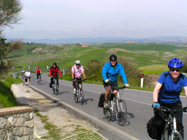 Cyclists on Tuscan country road